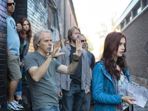 Director Harald Zwart, hands up, sets a shot as Lily Collins, notes in hand, and the crew listen.
