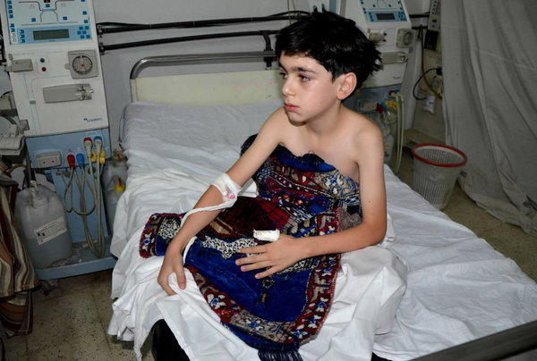 A boy, affected by what activists say is nerve gas, is treated at a hospital in the Duma neighbourhood of Damascus.