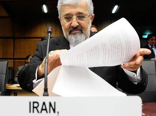 Iran's International Atomic Energy Agency IAEA ambassador Soltanieh sorts documents before an IAEA meeting in Vienna.