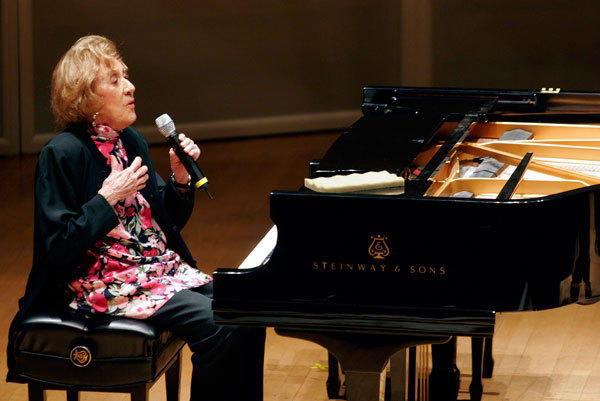 Pianist Marian McPartland introduces the next jazz tune to the audience at the Symphony Center in Chicago.