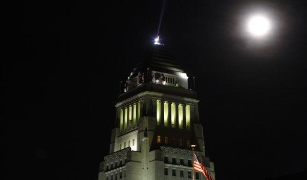 One kind of blue moon, the second in one calendar month, rises over Los Angeles City Hall on Dec. 31, 2009. A different kind of blue moon rose Tuesday night.