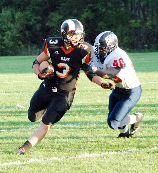 Harbor Springs senior running back David Walker (left) decided to back out of his verbal commitment to Western Michigan University to explore more college options.