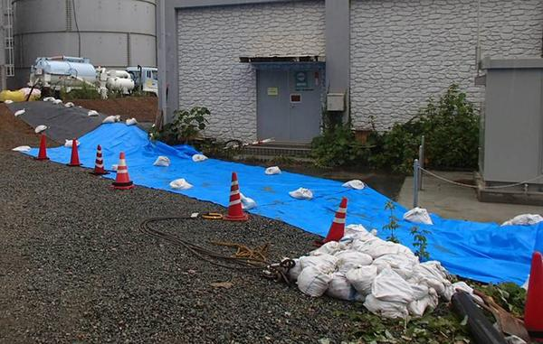 Tarps and barriers are deployed to counter the spread of radioactive water at the crippled Fukushima Daiichi Nuclear Power Plant in Japan.