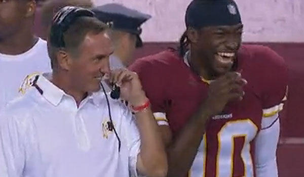 Washington Coach Mike Shanahan and quarterback Robert Griffin III share a laugh on the sideline Monday night.