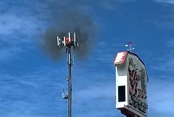 Cell phone tower on fire next to The Barn club, on 17-92 in Sanford, Wednesday, August 21, 2013.