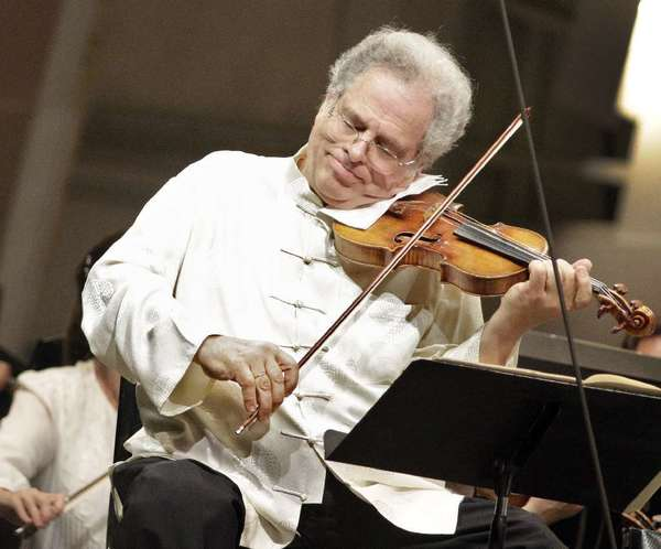 Itzhak Perlman is seen performing with the Los Angeles Philharmonic at the Hollywood Bowl in 2011.