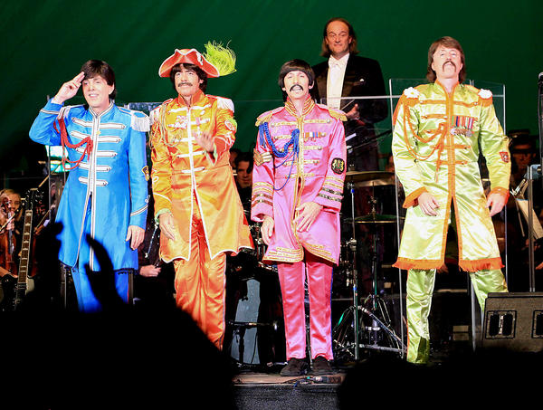 "Faux Beatles: Jim Owen, Tony Kishman, David John and Joe Bologna, impersonators of the Beatles, took Pasadena Pops guests on a ""Classical Mystery Tour: Music of the Beatles"" at a concert held at the Los Angeles Arboretum in Arcadia."