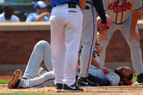 Atlanta Braves right fielder Jason Heyward spits blood after getting hit in the face by a pitch from New York Mets starting pitcher Jonathon Niese (not pictured) during the sixth inning of a game at Citi Field.