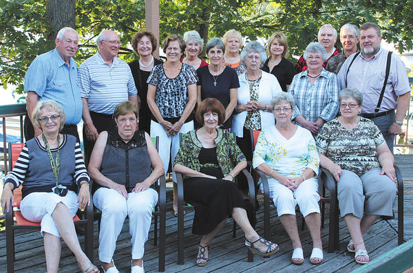 """Those attending the Hancock High Class of 1963 reunion trip included, front row, seated, from left, Sharon Eversole Ruppenthal, Marion Hull Hovermale, Susan Weaver Hinckle, Nancy Scriever and Linda Little Litton. Back row, Donald Snyder, Douglas McCusker, Charity Munson Miller, Carole Ruppenthal McCarty, Darlene Egolf Smith, Ruth Ann McCarty Golden, Carol Walls Swope, Linda Wolford Hull, Norma """"Jeanie"""" Purnell Carson, Wilma """"Jeanie"""" Shoemaker Cook, John Robinson, Carl Pelton and Lynn Singleton."""