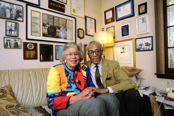 "Sedrick and Alyce Rawlins sit in the den of their Manchester home beneath walls decorated with mementos of their decades of service in the Hartford community. Sedrick Rawlins, a retired dentist, travelled to Washington, D.C. fifty years ago with a small group from Hartford for the March on Washington where Dr. Martin Luther King Jr. delivered the ""I Have A Dream"" speech."