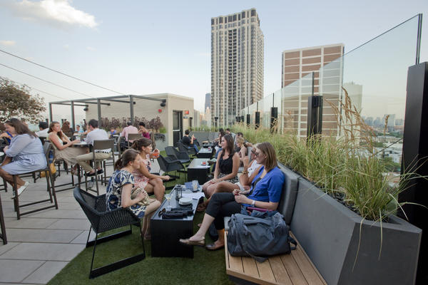 Combine DJ beats, sparkling wine and sunshine at brunch at Lincoln Park's J. Parker.