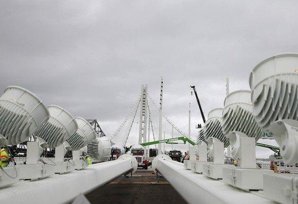 Two light poles sit on the deck of the new Bay Bridge earlier this month. The bridge has been under construction since 2002, with an estimated price tag of $6.4 billion.