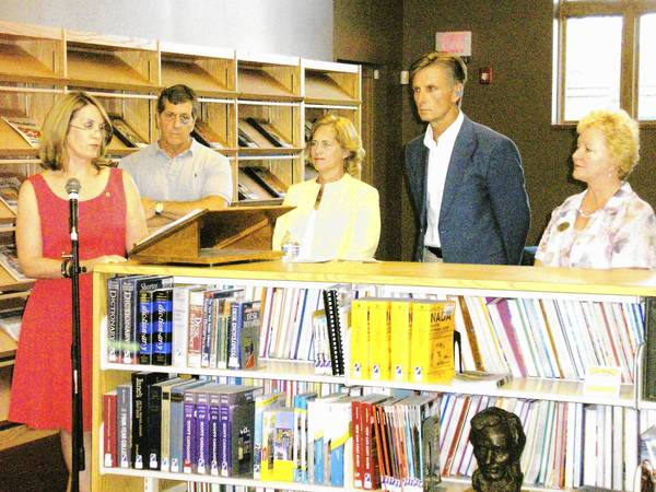 "From left to right, Jody Olivieri, Michael Olivieri, Homer Township Public Library Secretary Phyllis Levine, Library Board President Edward O'Brien and Library Director Sheree Kozel-La Ha stand during the Aug. 16 dedication ceremony of the Michael C. Olivieri Heroes Quiet Reading Room. The room was created in honor of the Olivieri family's son, Pfc. Michael ""Mike"" C. Olivieri, who died in Iraq on June 6, 2011."