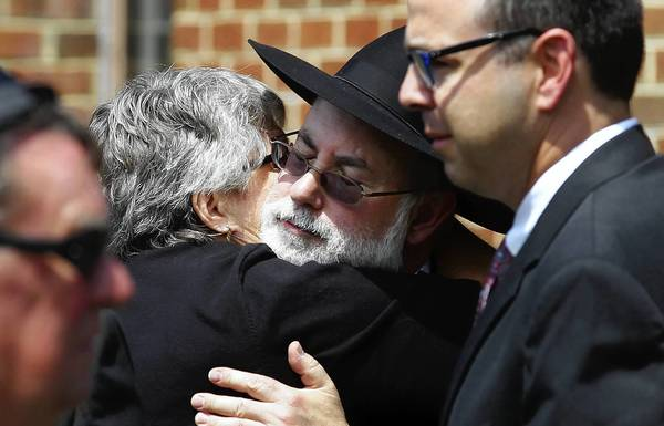 David Segaloff son of An Achievable Dream founder Walter Segaloff is hugged by a supporter after funeral services for his father.