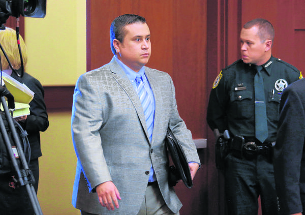George Zimmerman returns to the courtroom during a recess in Seminole circuit court during his trial in Sanford on June 12, 2013.