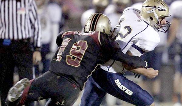 Alemany linebacker Quentin Tartabull sacks St. John Bosco quarterback Rene Medina on Nov. 18, 2011.