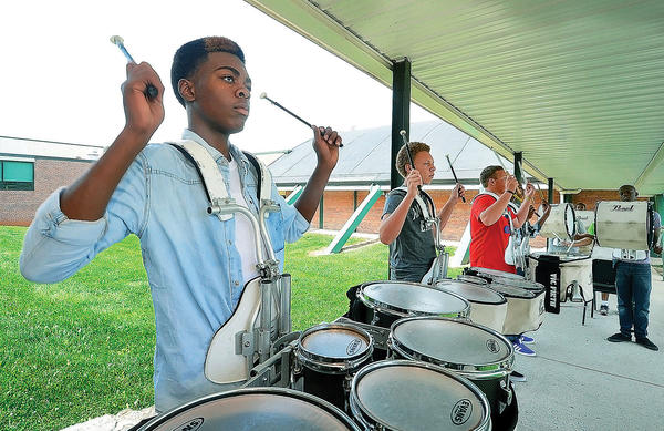 Devin Moorer, a sophomore at South Hagerstown High School and other members of the drumline play their instruments outside during the first day of school in Washington County.