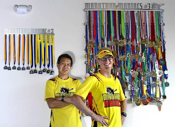Two of the three originals of the Marathon Maniacs and Half Fanatics running clubs, from left, Steve Yee, of Bonney Lake, Wash., Tony Phillippi of Tacoma, Wash., along with Chris Warren (not pictured) have grown a local club into a worldwide running organization with more than 11,000 combined members.