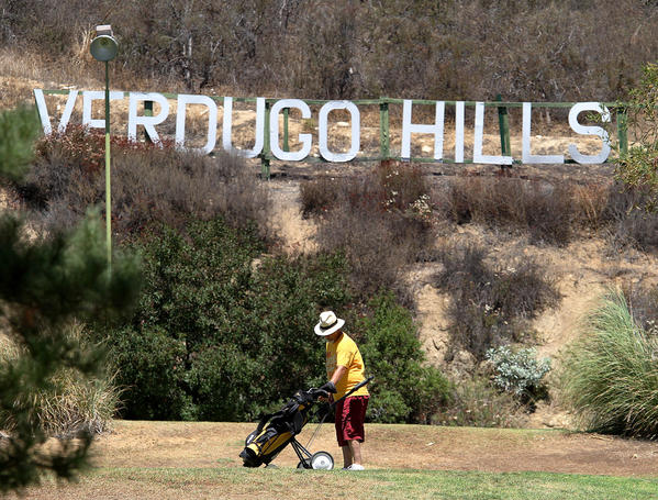 A golfer sets up for a putt at Verdugo Hills Golf Course in Tujunga for on Wednesday, Aug. 21, 2013. The City of Glendale has adopted a resolution backing the City of Los Angeles in declaring the golf course a historic site.