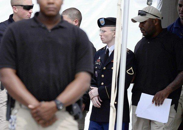 Bradley Manning is escorted from court at Ft. Meade, Md., after his sentencing. In addition to his prison term, he was demoted to private, lost his Army pay and received a dishonorable discharge.