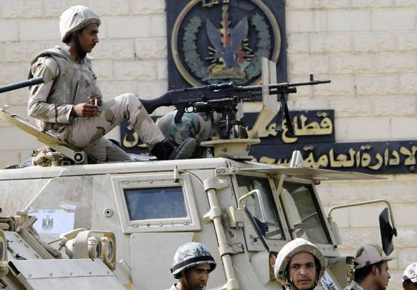 Egyptian soldiers guard Tora prison, where ousted President Hosni Mubarak is being held. A court ordered his release, which is expected Thursday.