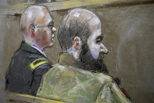 U.S. Army Maj. Nidal Malik Hasan, in beard, is shown with a military attorney who is advising him, Lt. Col. Kris Poppe, at Fort Hood, Texas, during Hasan's court-martial. Hasan is charged with killing 13 people and wounding 32 during a rampage at the Ft. Hood Army base in 2009.