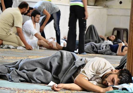 A survivor from what activists say is a gas attack rests inside a mosque in the Duma neighbourhood of Damascus.