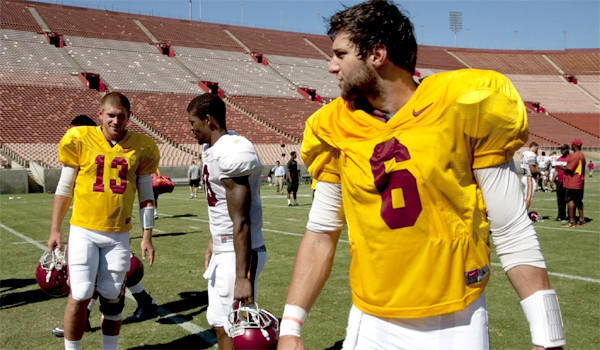 USC quarterbacks Max Wittek, left, and Cody Kessler, right, walk off the field after a team scrimmage at the Coliseum on Aug. 16, 2013