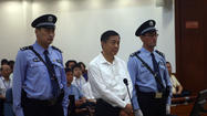 As trial begins in China, Bo Xilai contests some charges