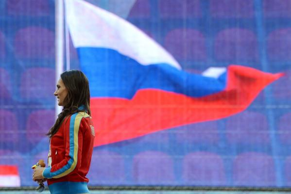 Russia's Yelena Isinbayeva smiles on the podium during the medal ceremony for the women's pole vault at the 2013 IAAF World Championships at the Luzhniki stadium in Moscow on August 15.