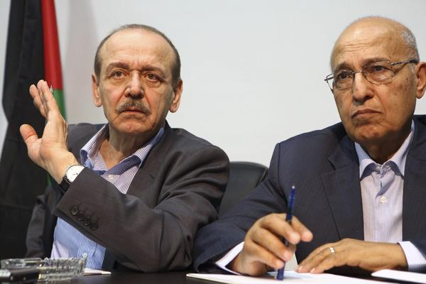 Yasser Abed-Rabbo, left, with Nabil Shaath, told Voice of Palestine radio that Israel objected to an American seat at the negotiating table.