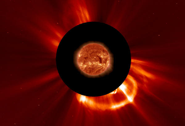 A satellite known as the Solar and Heliospheric Observatory captured this image Tuesday of an Earth-directed coronal mass ejection. Scientists black out the brightness of the sun's corona to better see the particles erupting.