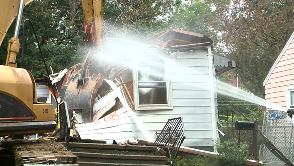 Demolition crews raze the home at 68 Charter Oak Avenue in East Haven on Thursday.