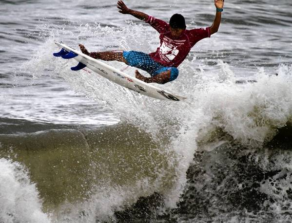 Jairo Perez takes to the air as he competes in the Mens Division of the East Coast Surfing Championships in Virginia Beach in 2010.
