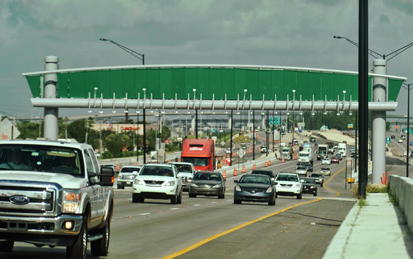 The gantry that will eventually read Sunpass transponders on the 595 reversible lanes is already in place, as seen Thursday, Aug. 22, 2013.