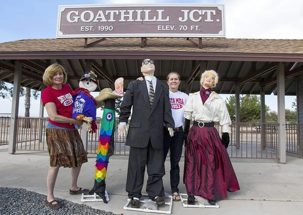 "Charlene Ashendorf and Tess Bernstein, co-chairs of the 60th Anniversary Educational and Historical Programs, pose with an assortment of scarecrows. The scarecrows include replicas of Charles and Julia ""Goldie"" TeWinkle. A scarecrow contest will take place at on Oct. 12-13 at the Goat Hill Junction Train Station during the Pumpkin Festival."