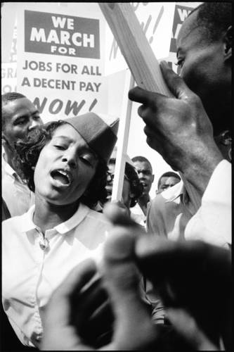 "The March on Washington for Jobs and Freedom took place in front of the Lincoln Memorial in Washington and called for civic and economic rights for African-Americans. The event culminated with Martin Luther King Jr.'s ""I Have a Dream"" speech."