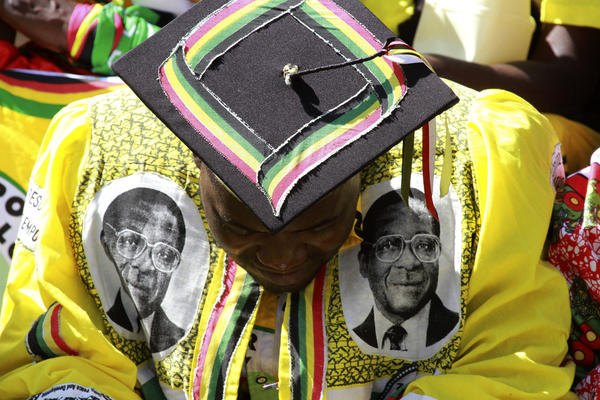 A supporter of Zimbabwean President Robert Mugabe attends his inauguration in Harare, the capital.