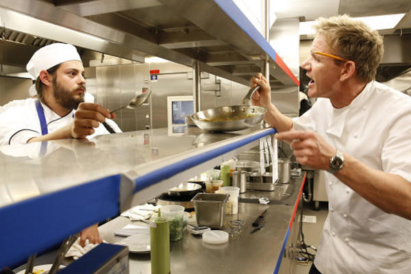 Chef Gordon Ramsay, right, berates James during the restaurant takeover challenge.