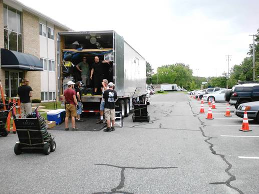 "The ""House of Cards"" film crew unloads equipment outside the Edgewood Park Aprartments on Thursday morning in preparation for an afternoon shoot."