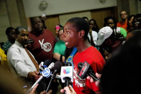 "Parrish Brown, 17, who will be attending Dyett High School, speaks to reporters outside Mayor Rahm Emanuel's office as Chicago parents, students and advocates impacted by budget cuts and school closings call for a citywide ""Education is a Human Right"" one-day boycott of Chicago Public Schools. The boycott is to take place on August 28th in front of the Chicago Board of Education and then march to City Hall."