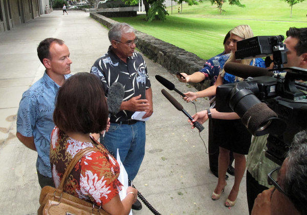 Chairman William Aila of the Hawaii Department of Land and Natural Resources, center, speaks to reporters at a news conference in Honolulu on Tuesday.