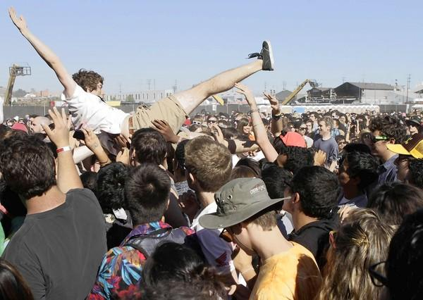 A fan crowd-surfs during a performance at the 2012 FYF Fest.