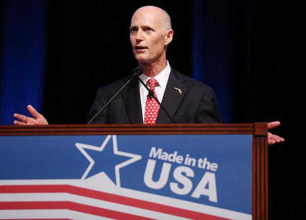 Florida Governor Rick Scott speaks during a Walmart U.S. Manufacturing Summit at the Orange County Convention Center in Orlando on Thursday, August 22, 2013.