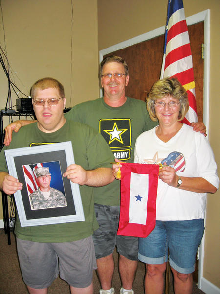 From left, Kevin Swiger, Michael Swiger, Teresa Swiger, family of Christopher Swiger, were given a Blue Star Banner. Christopher Swiger is stationed at Fort Riley, Kansas.