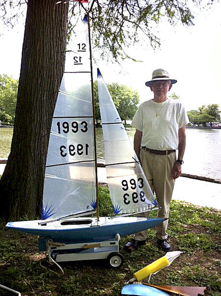 Chambersburg, Pa., resident Mike Cavanaugh shows the East Coat 12 model yacht he raced around the larger lake at Hagerstowns City Park in June. Cavanaugh joins other model yacht skippers Sunday, Aug. 25, to race in a regatta at City Park.