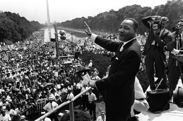 "This August 28, 1963 file photo shows US civil rights leader Martin Luther King (center) waving from the steps of the Lincoln Memorial to supporters on the Mall in Washington, DC, during the ""March on Washington"". US President Barack Obama will mark the 50th anniversary of Martin Luther King's ""I have a dream"" speech by speaking from the same steps at the Lincoln Memorial in Washington. The August 28 event in the US capital will take place on the exact spot where King delivered his famous address on the same day in 1963."