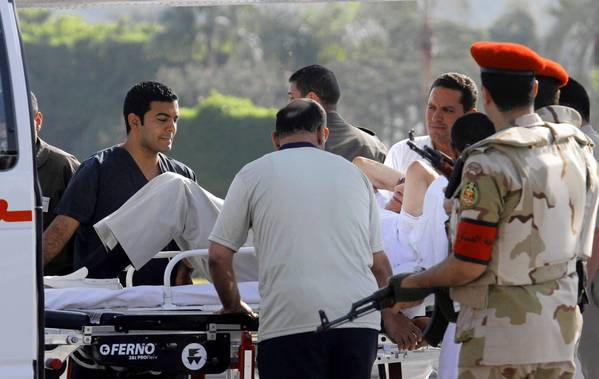 Egypt's former president, Hosni Mubarak, is transferred on a gurney to an ambulance after arriving by helicopter at a military hospital in Cairo.