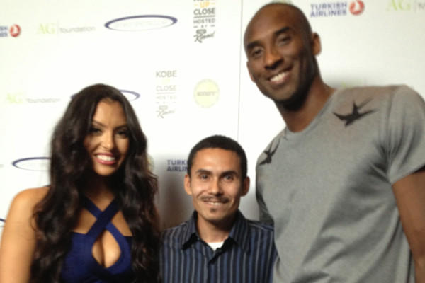 "Army Sergeant Anthony Zavala, center, stands with Vanessa and Kobe Bryant before the ""Kobe Up Close Hosted by Jimmy Kimmel"" event on Aug. 15."