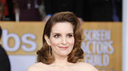 Tina Fey says she's become 'human napkin' for two daughters